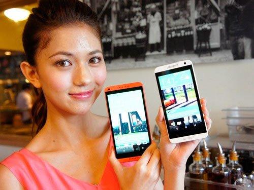 Девушка с моделями HTC Desire 816 и 610